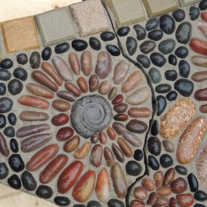 A close-up of the colourful stones in the mosaic map.